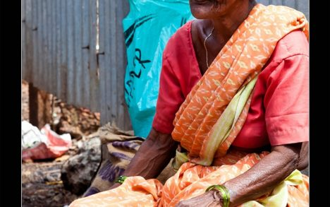 Old Indian woman selling rice