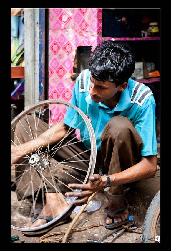Indian bicycle repairman