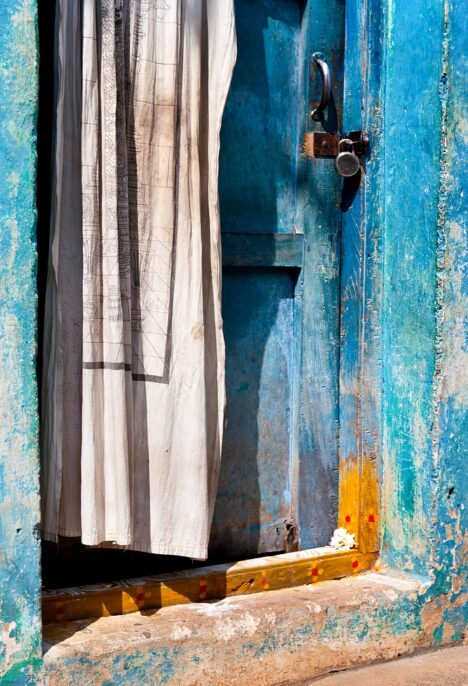 Oude blue door with curtain